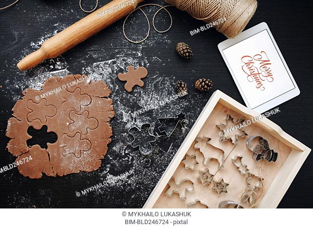 Digital tablet, gingerbread dough and pastry cutters