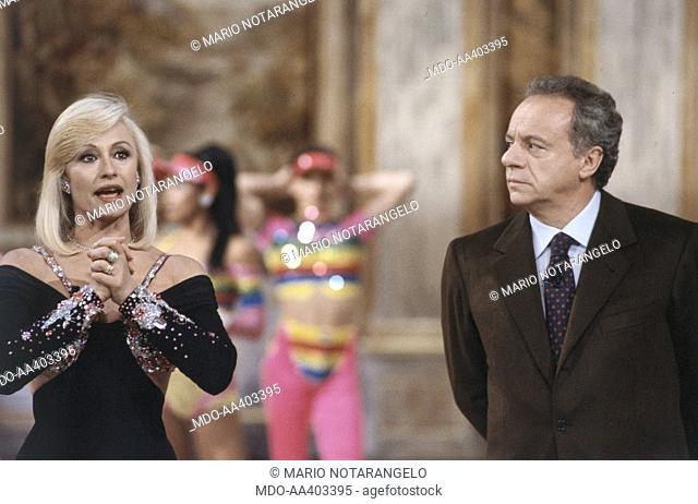 Johnny Dorelli looking at Raffaella Carrà in Fantastico 12. Italian actor and singer Johnny Dorelli (Giorgio Guidi) looking at Italian showgirl Raffaella Carrà...