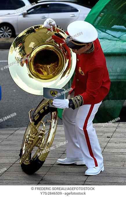 Military man in uniform holding sousaphone in Seoul,South Korea