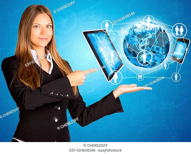 Businesswoman in suit. Earth and electronics. Elements of this image are furnished by NASA