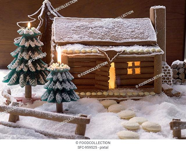 Gingerbread log cabin in snowy forest