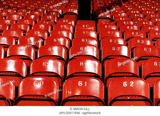 Red seats at a sports stadium