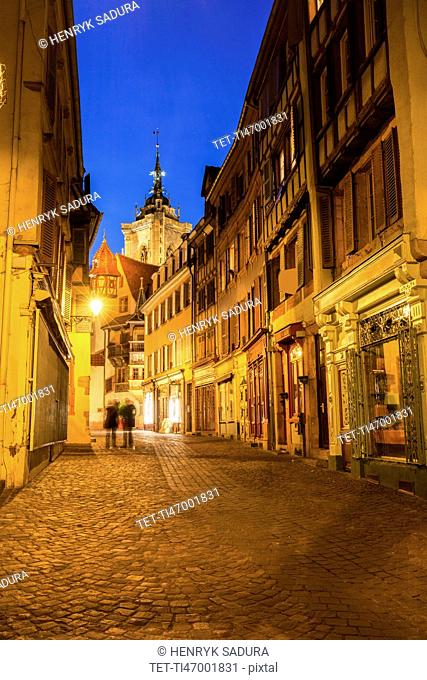 France, Grand Est, Colmar, Incidental people in long exposure with St Martin Church background