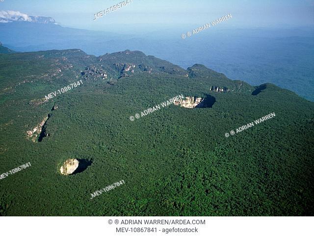 Venezuela - aerials of Tepuis, South America. Sarisarinama sink hole with rainforest, Jaua-Sarisarinama National Park at the far south-west of Bolivar State