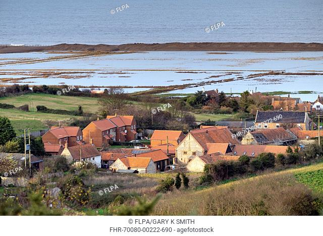 View of coastal village with flooded freshmarsh habitat after tidal surge, Salthouse, North Norfolk, England, December 2013
