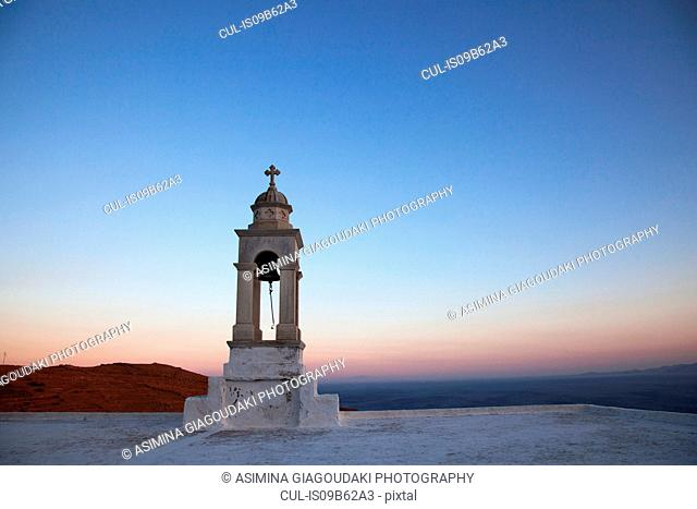 Chapel bell tower at sunset, Tinos Island, Greece