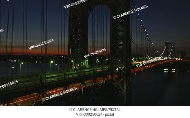 (Time-lapse) Morning rush hour traffic on the George Washington Bridge crosses the Hudson River between New Jersey and New York just before sunrise