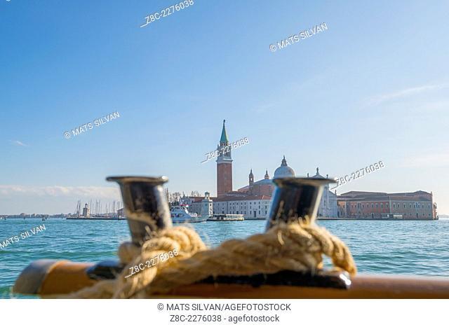 Island San Giorgio Maggiore with blue sky seen from a boat in Venice, Italy