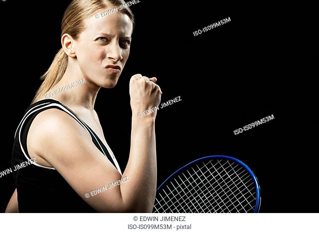 Tennis player punching the air
