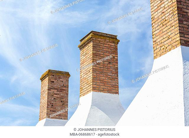 Chimneys of a smokehouse in Snogebæk, Europe, Denmark, Bornholm