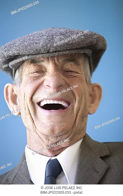 Portrait of elderly man laughing