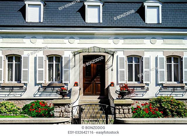 Typical alsacien house in small village, Bas-Rhin, France. Tourism and travel concept