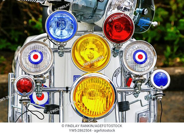 Headlights and spotlights on a Scooter decorated in MOd design