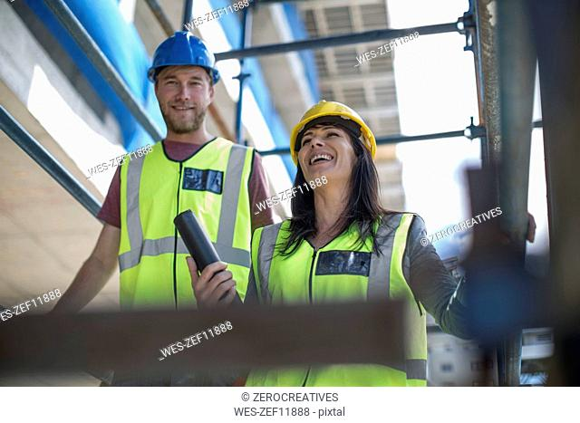 Two engineers inspecting construction site