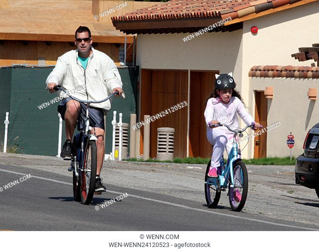 Adam Sandler cycles through Malibu, California with his daughter Featuring: Adam Sandler, Sadie Sandler Where: Los Angeles, California