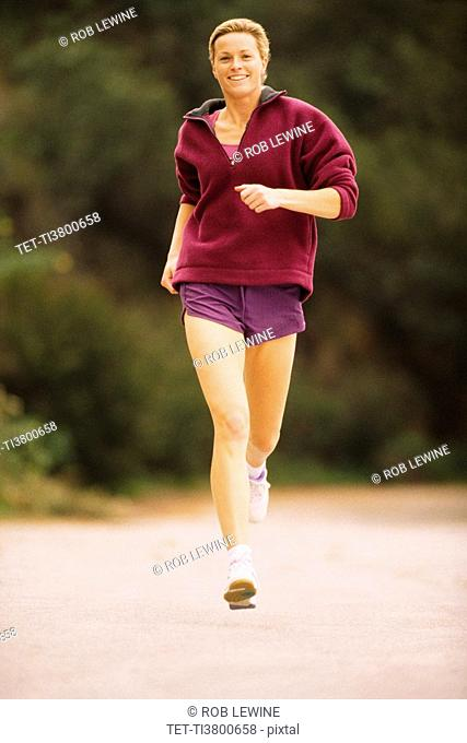 Woman jogging down the street
