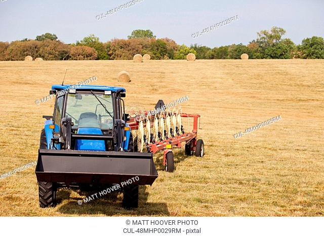 Tractor and thresher in crop field
