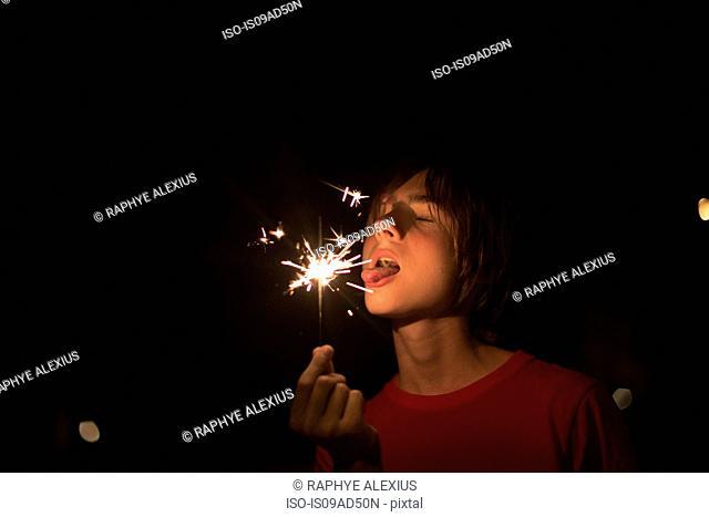 Portrait of boy holding sparkler on independence day, Destin, Florida, USA