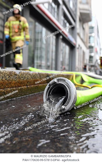 Firefighters pump water out of a basement in the Mitte district of Berlin, Germany, 30 June 2017. The state of exception in Berlin due to bad weather will...