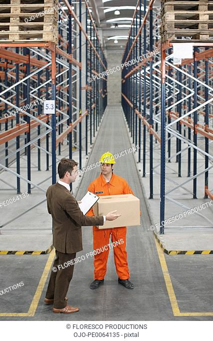 Men working in warehouse