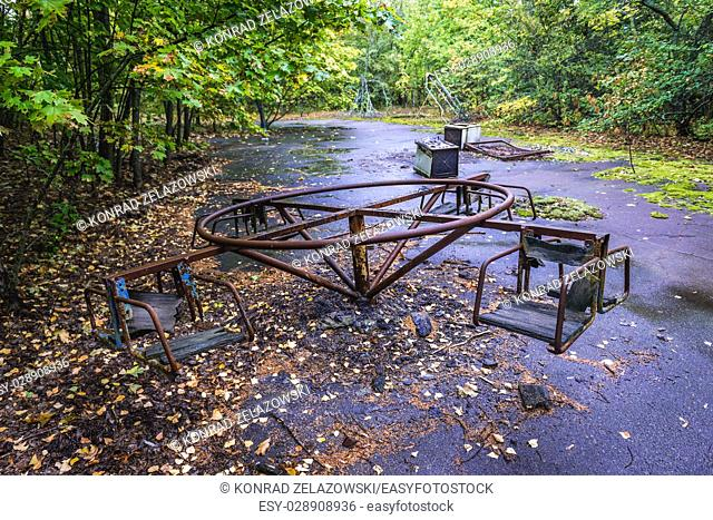 Playground in Pripyat ghost city of Chernobyl Nuclear Power Plant Zone of Alienation around nuclear reactor disaster in Ukraine