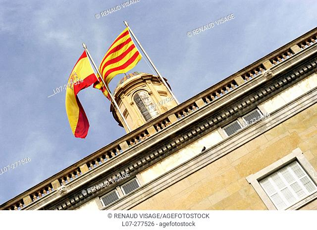 Palau de la Generalitat building facade with Spanish and Catalan flags. Barcelona. Spain