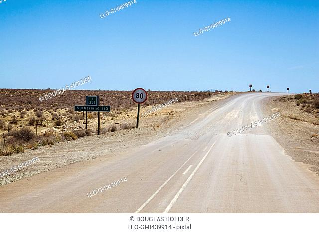 A dusty road through the Karoo. The distance is in kilometres and the speed limit is in kilometres per hour, Fraserburg, Northern Cape Province, South Africa