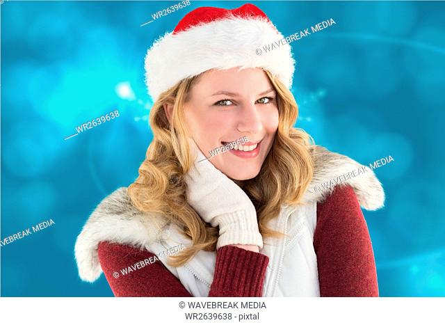 Beautiful woman in santa hat smiling at camera