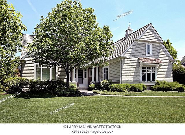 Suburban brick home with white columns