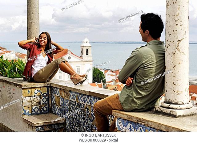 Portugal, Lisboa, Alfama, Miradouro de Santa Luzia, young woman telephoning