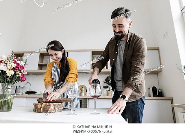 Happy couple preparing lunch together in the kitchen