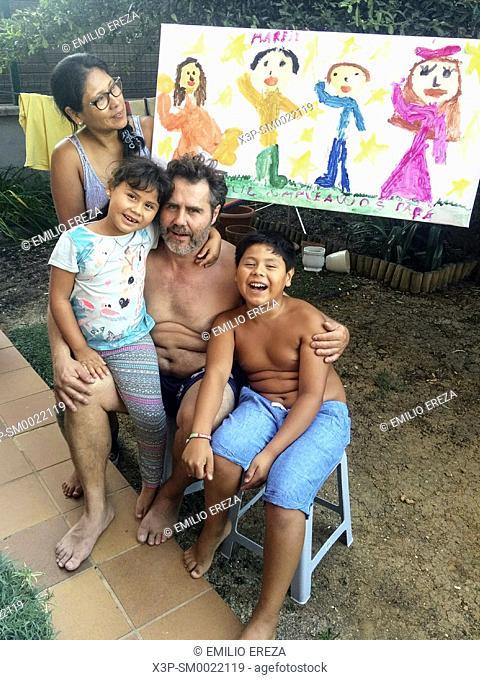 Interracial family. Celebrating dad's birthday