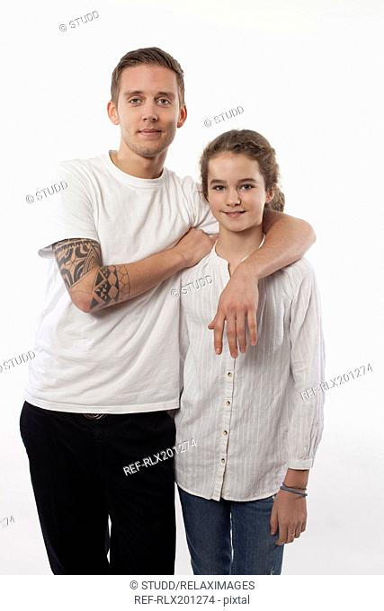 Brother and sister smiling teenagers portrait two
