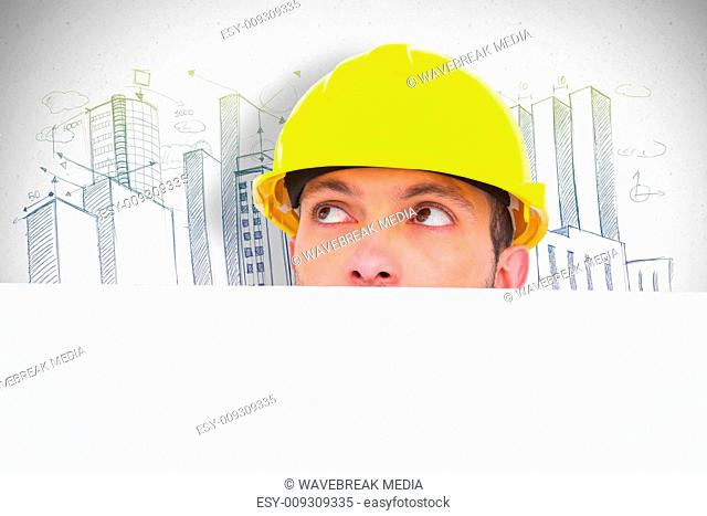 Composite image of handyman hidden behind blank board