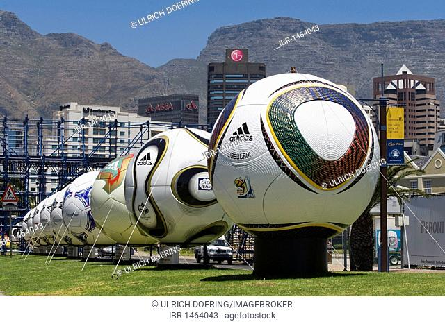 Jabulani, the official match ball of the 2010 World Cup, right, in a row of balls with replicas of past FIFA World Cups, Cape Town, South Africa, Africa