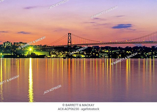 Angus L  MacDonald Bridge reflected in harbour at dusk, Halifax, Nova Scotia, Canada