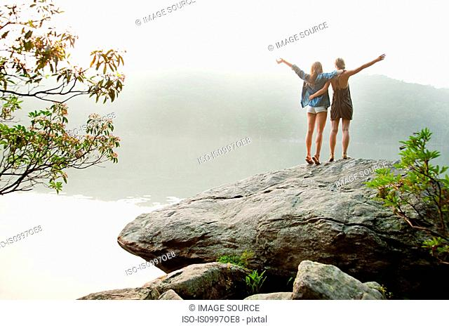 Young women looking out over lake