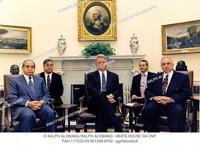 United States President Bill Clinton, center, meets in the Oval Office of the White House with Lieutenant General Hikmat al-Shiabi, Chief-of-Staff of Syria