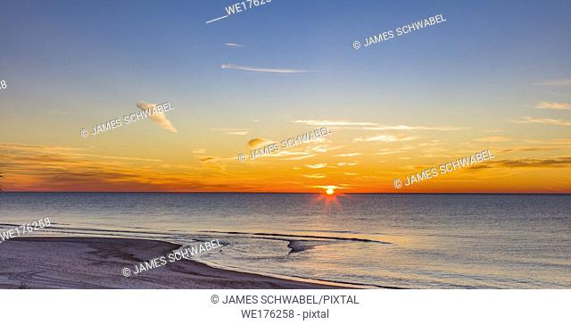 Sunrise over Gulf of Mexico on St George Island in the panhandle or forgotten coast area of Florida in the United States