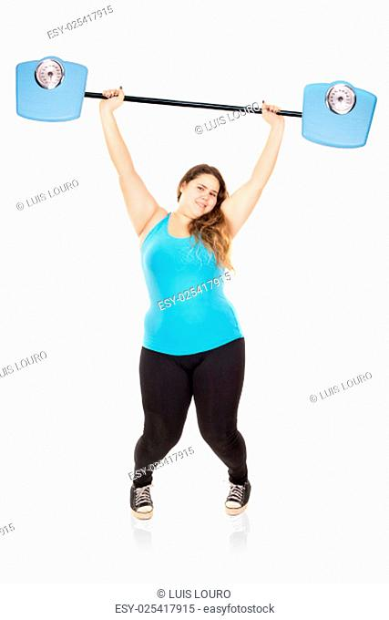 Beautiful large girl lifting weights made of weight scales isolated in white