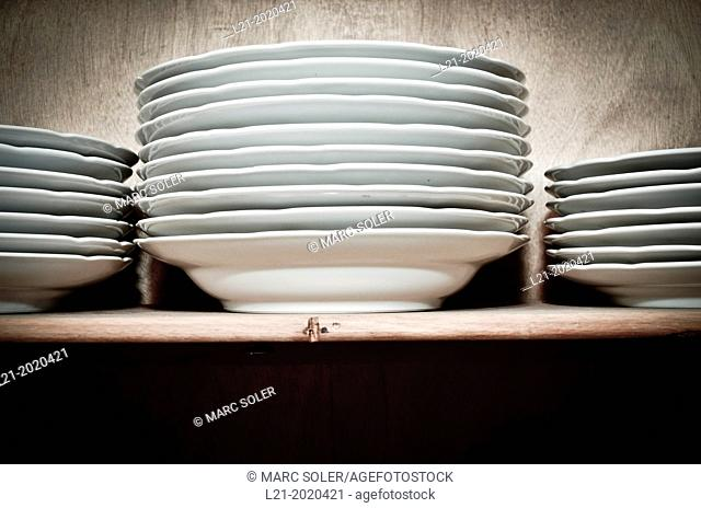 Stack of dishes in a cupboard