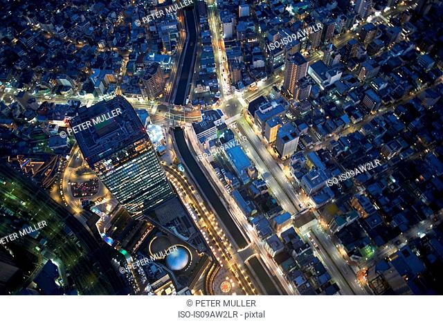 Overhead view of skyscrapers and highways at night, Tokyo, Japan