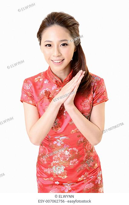 Smiling Chinese woman dress traditional cheongsam at New Year, studio shot isolated on white background