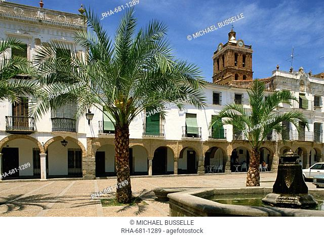 Fountain and palm trees in the town square in Zafra, Extremadura, Spain, Europe
