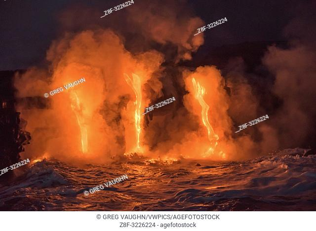 Lava from Pu'u O'o eruption flowing into ocean on the Kalapana coast, Hawaii Volcanoes National Park, Big Island of Hawaii