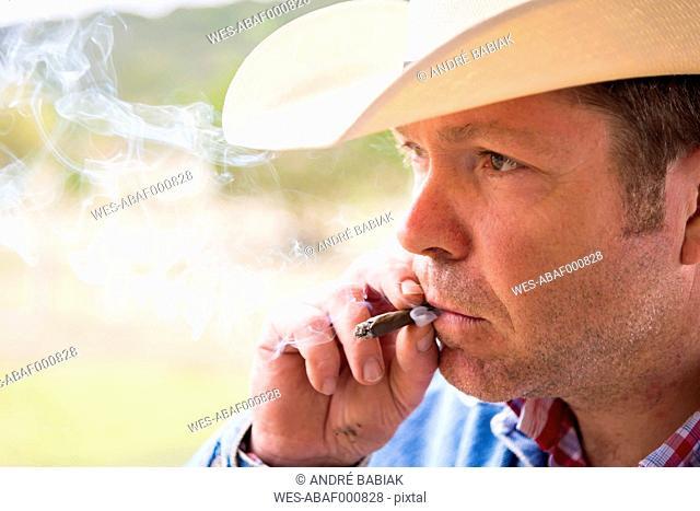 Texas, Cowboy smoking cigar, close up