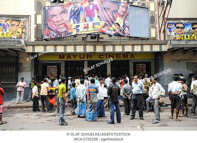 Kolkata, West Bengal, India, Asia - A crowd of Indian men is waiting outside a cinema