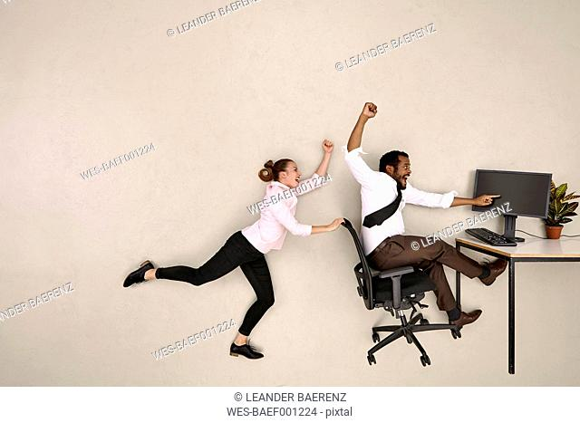Business colleagues shouting at computer