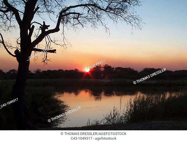 Namibia - Sunset at the Okavango River which is border river between Namibia and Angola the sun is setting on the Angolan side  Kavango region, Namibia
