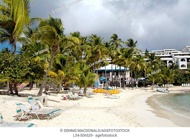 The cruise ship Cranival Fantasy from Port Canaveral visits the caribbean Island of St. Thomas in the West Indies Sapphire Beach